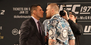 Rafael-dos-Anjos-Conor-McGregor-UFC-197-01-750x3701